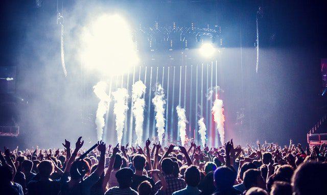 concert with lights and smoke